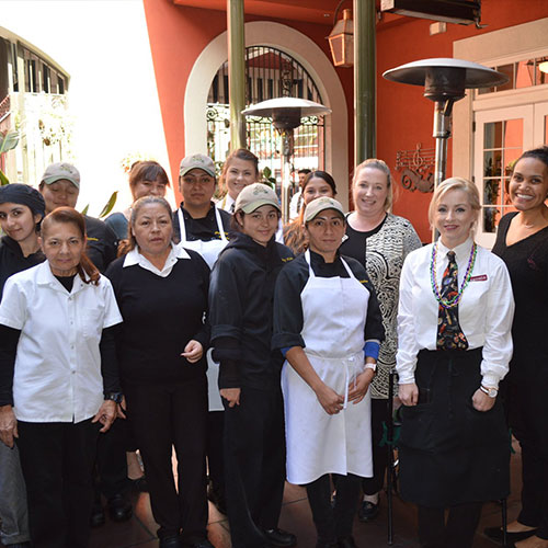 Group shot of Jazz Kitchen employees in the courtyard