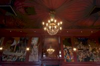 Beautiful chandelier and artwork in our Queens Room