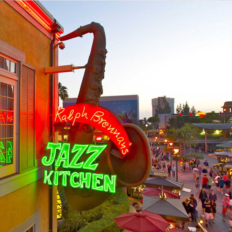 Outside photo of the Jazz Kitchen signage with crowd walking by