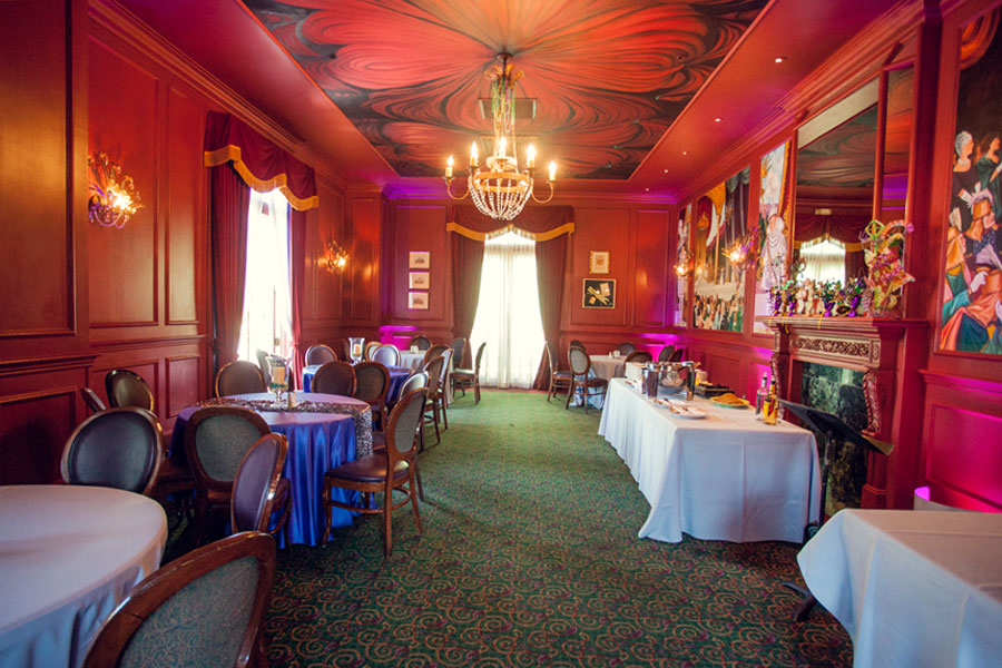 Photo of Queen's Room with red walls and seating setup for private event